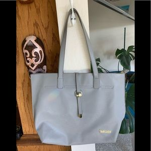 Light gray Kenneth Cole reaction purse.